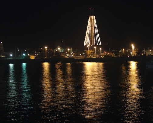 Pilgrim Monument and Provincetown Museum decorated with lights for Holiday Season