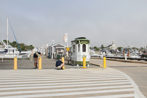 Provincetown Harbor MacMillan Pier, Mayflower ticket booth and Provincetown Library on the horizon